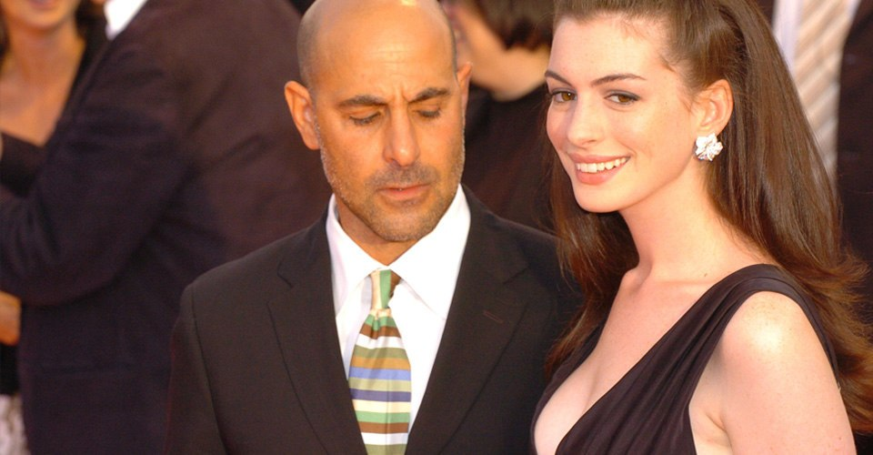 Stanley Tucci looks at Anne Hathway breasts